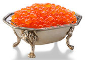 Red caviar is in a silver bowl — Stock Photo