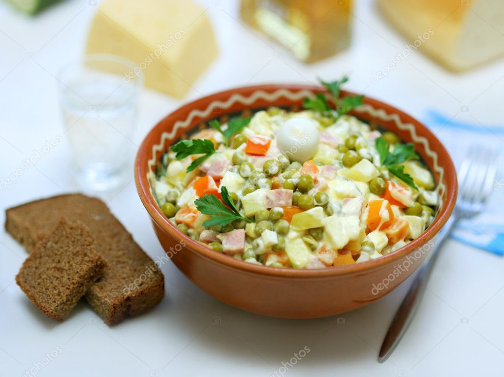 Homemade variant of Russian Salad and pieces of bread near  — Stock Photo #3608414
