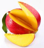 Mango with lobules on a white background — Stock Photo