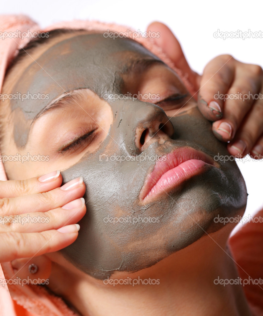 Beauty-spa. Applying of cosmetic mud mask. Close face of young woman  Stock Photo #3611355