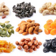 Groups of various kinds of dried fruits on white background - Stock Photo