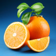 Ripe orange on a blue background — Stock Photo