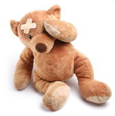 Ill teddy bear with plaster on its head — Stock Photo