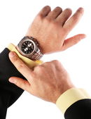 Businessman looks at his watch — Stock Photo