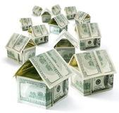 Dollar house community isolated over white. — Stock Photo