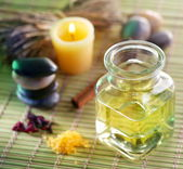 Still life with massage oil in the spa salon — Stock Photo