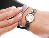 Businesswoman looks at his watch — Stockfoto