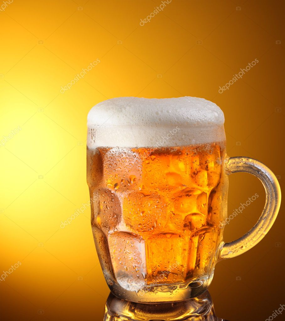 Glass of beer on a yellow background — Stock Photo #3625298