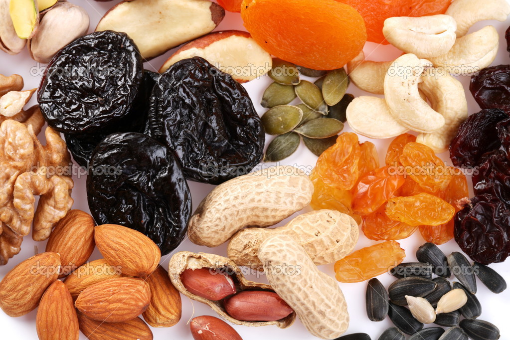 Close seeds and dried fruits on white background  Stock Photo #3625486