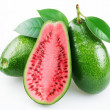 Flesh of watermelon on the cut avocado. - Stock Photo