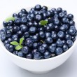 Crockery with blueberries. - Stock Photo