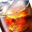Glass of cola with ice cubes — Stock Photo