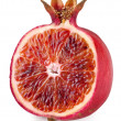 Red orange cut ripe pomegranate. Product of genetic engineering. - Stock Photo
