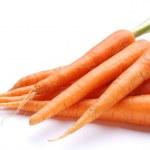 Ripe fresh carrots on a white background. — Stock Photo #3657560