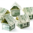 Dollar houses isolated over white — Stock Photo