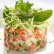 Royalty-Free Stock Photo: Salad with salmon, caviar and arugula on a white background