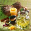 Still life with massage oil in spsalon — Stock Photo #3658312