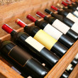 Closeup shot of wineshelf. - Foto de Stock