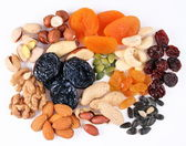 Groups of various kinds of dried fruits on white background — Stock Photo