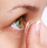 Human eye with corrective lens on a white — Stock Photo