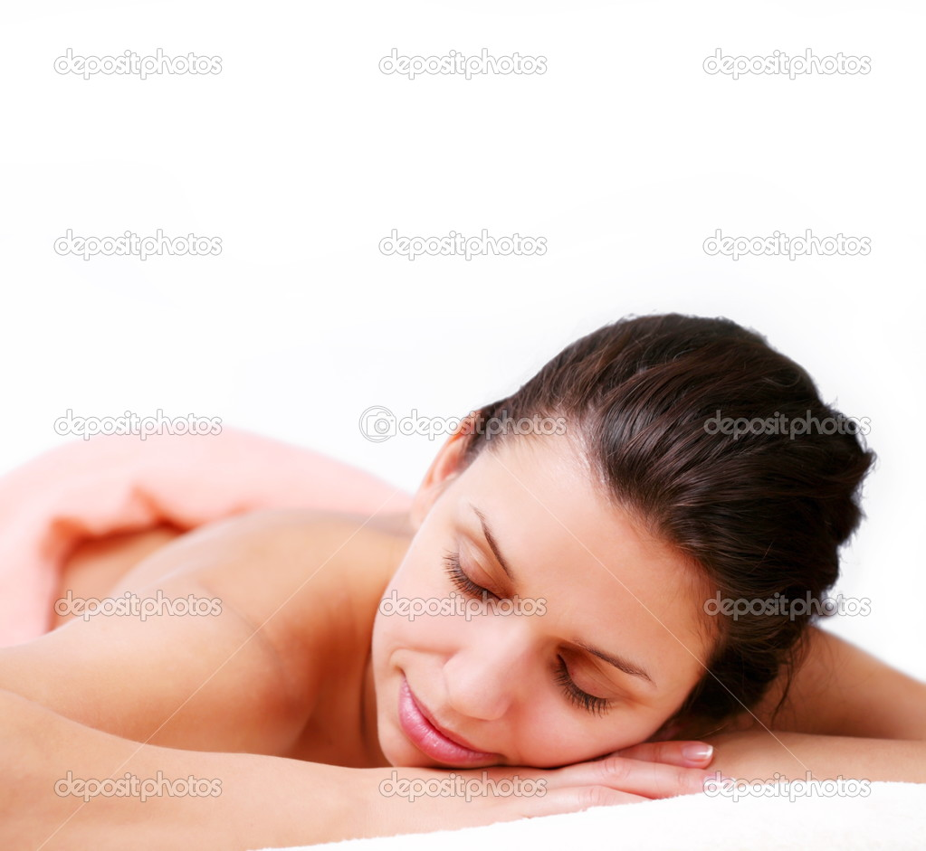 Young woman gets a massage. Eyes are closed.  Stock Photo #3650455