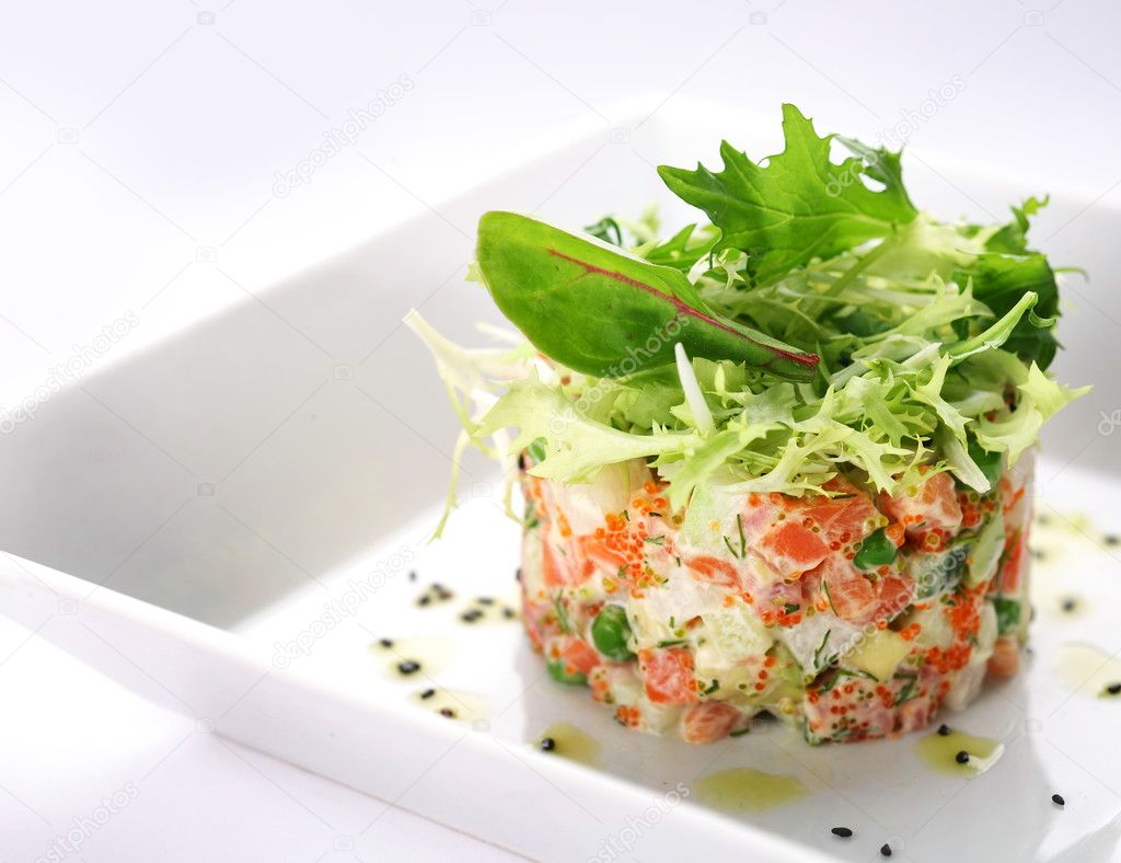 Salad with salmon, caviar and arugula on a white background — Stock Photo #3653336