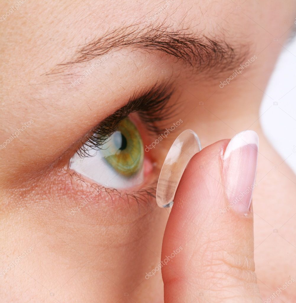 Human eye with corrective lens on a white — Stock Photo #3658134