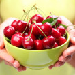 Royalty-Free Stock Photo: Crockery with cherries in woman hands.
