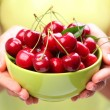 Stok fotoğraf: Crockery with cherries in womhands.