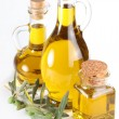 Branch with olives and a bottles of olive oil isolated on white — Stock Photo