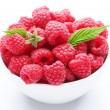 Stock Photo: Crockery with beautiful tempting raspberries. Isolated on white