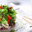 Royalty-Free Stock Photo: Salad with eruca and octopus on a white plate