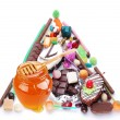 Pyramid in the form of sweets. Isolated on white - Foto Stock