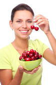 Woman with crockery of cherries in her hands. — Foto Stock