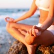 Body of a beautiful girl in a meditation on the beach — Stock Photo
