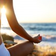 Body of a beautiful girl in a meditation on the beach — Stock Photo #3834326