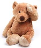 Teddy bear in een punt van zorg. geïsoleerd over wit. — Stockfoto