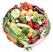 With vegetables in a circle. Isolated on white background — Stock Photo