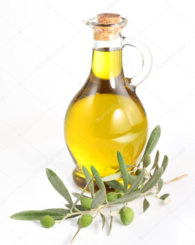 Branch with olives and a bottle of olive oil isolated on white — Stock Photo #3834565