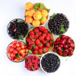 Summer wealth. Variety of berries. - Stock Photo