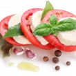 Ingredients for making salad with mozzarella and tomatoes on a w — Stock Photo