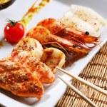 Sea food on a white dish — Stock Photo