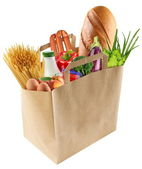 Paper bag with food on a white background — Stock Photo