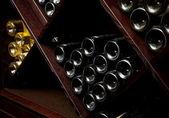 Snapshot of the wine cellar. The bottles on wooden shelves. — Stock Photo