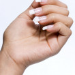 The refined beautiful female fingers with original design manicure — Stock Photo