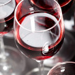 Composition from glasses with red wine on a grey background — Stock Photo
