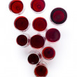 Composition from glasses with red wine in the form of a cluster of grapes — Stock Photo