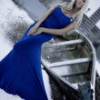 The lady in a blue dress on snow — Stock Photo