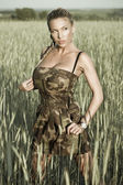 Fashion a portrait of the sexual girl on walk in field — Stock Photo