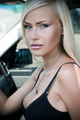 Portrait of a sexy woman in car — Stock Photo